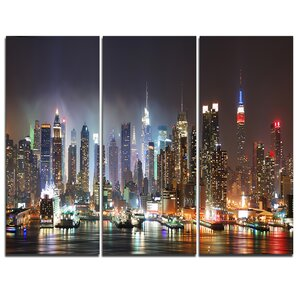 Lit NYC Manhattan Skyline - 3 Piece Graphic Art on Wrapped Canvas Set by Design Art
