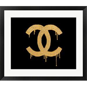 Glam Chanel '24 Karat Golden Lust' Framed Graphic Art Print by Buy Art For Less