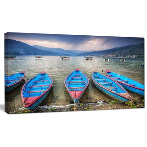 'Row of Blue Boats in Pokhara Lake' Photographic Print on Canvas by Design Art