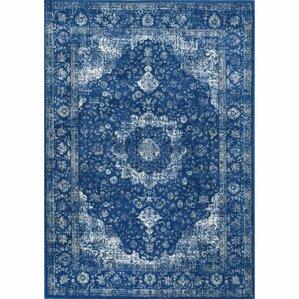 linden dark blue area rug