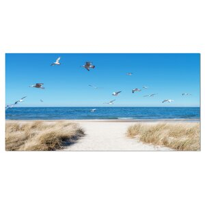 Beach with Seagulls in Rugen Island Seashore Photographic Print on Wrapped Canvas by Design Art