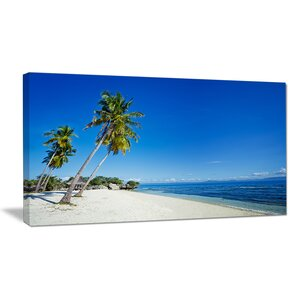 Palms Bent to Beautiful Vacation Beach Seascape Photographic Print on Wrapped Canvas by Design Art