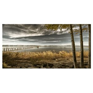 'Pier in Brown Lake' Photographic Print on Wrapped Canvas by Design Art