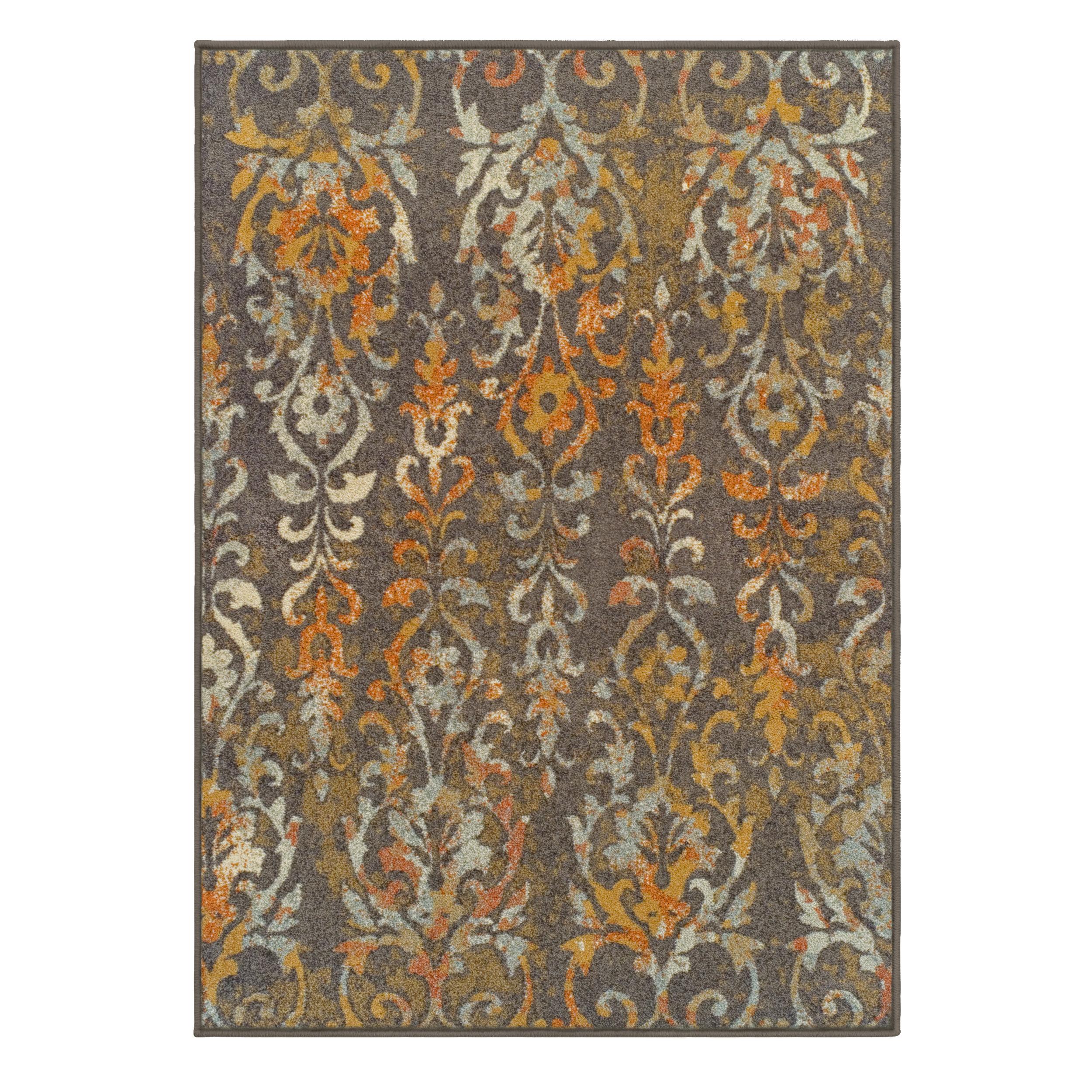 Fleur de lis living clemmie tan orange area rug wayfair