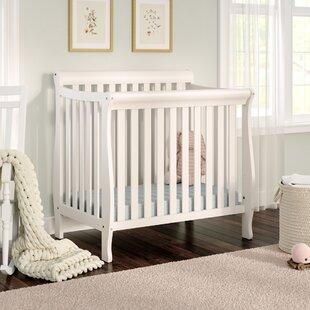 Find the perfect Jaden Mini Crib with Mattress Pad ByViv + Rae