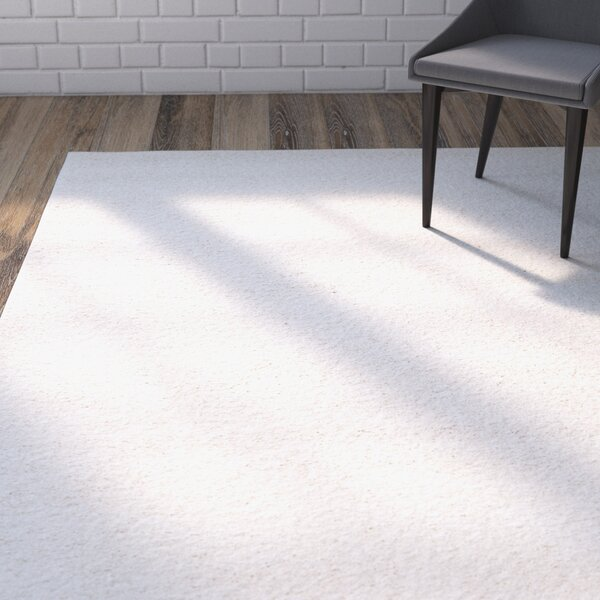 Starr Hill Solid Ivory Area Rug by Zipcode Design