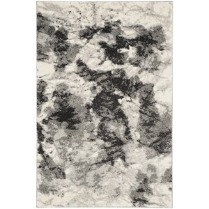 Bussiere Ivory / Gray Area Rug
