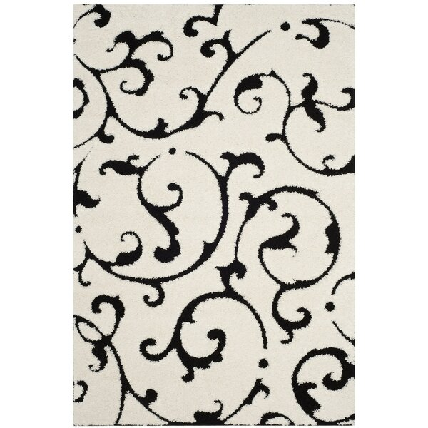 Tess Ivory/Black Area Rug by Winston Porter