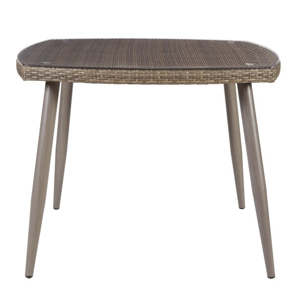 Gala Resin Wicker Dining Table by Highland Dunes