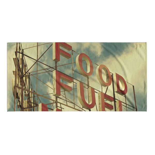 Food Fuel Motel Beach Towel by KAVKA DESIGNS