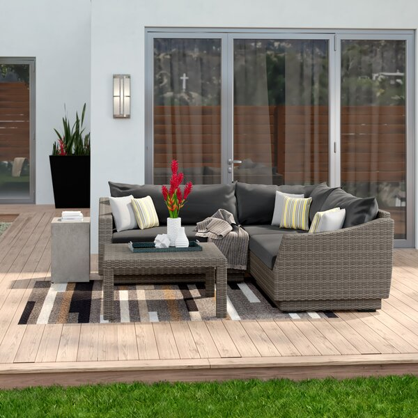 Castelli 4 Piece Rattan  Sectional Seating Group with Cushions by Wade Logan