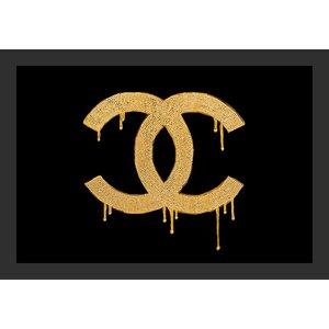 'Glam Chanel 24 Karat Golden Lust' Framed Graphic Art Print by Buy Art For Less