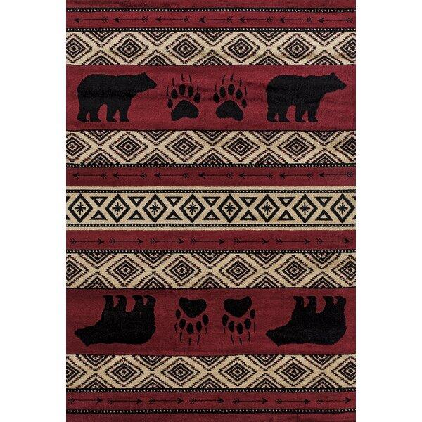 Pippen Bear Imprint Red/Beige/Black Area Rug by Loon Peak
