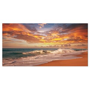 'Waves Under Colorful Clouds' Photographic Print on Wrapped Canvas by Design Art