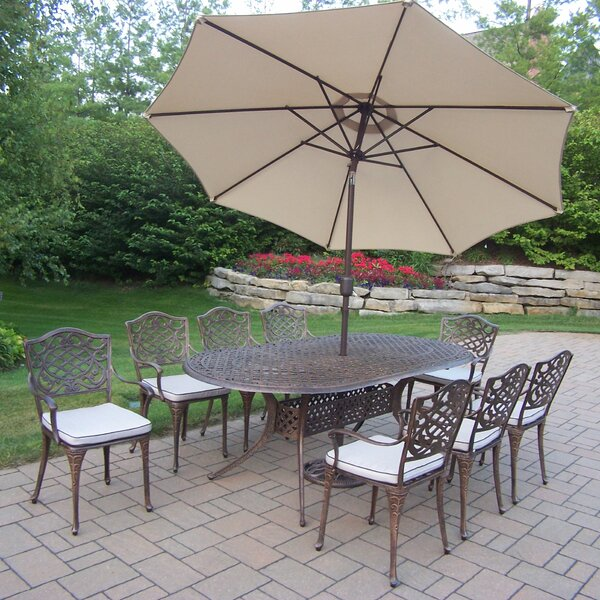 Mcgrady 9 Piece Dining Set with Cushions and Umbrella by Astoria Grand