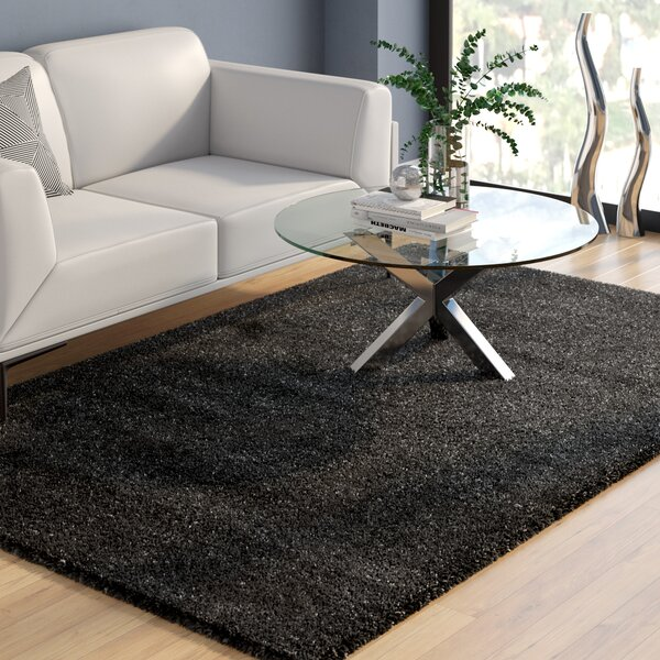 Rowen Black Area Rug by Wade Logan