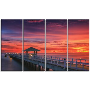 'Long Wooden Bridge and Colorful Sky' 4 Piece Graphic Art on Wrapped Canvas Set by Design Art