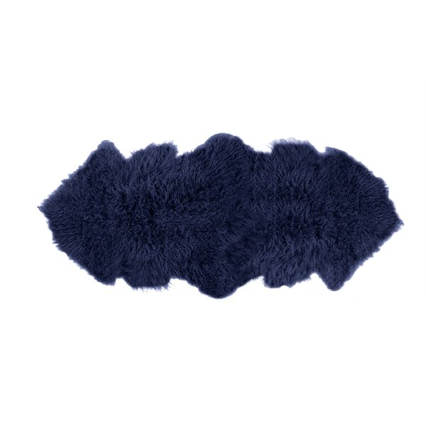 Rockwall Faux Sheepskin Blue Area Rug by Luxe