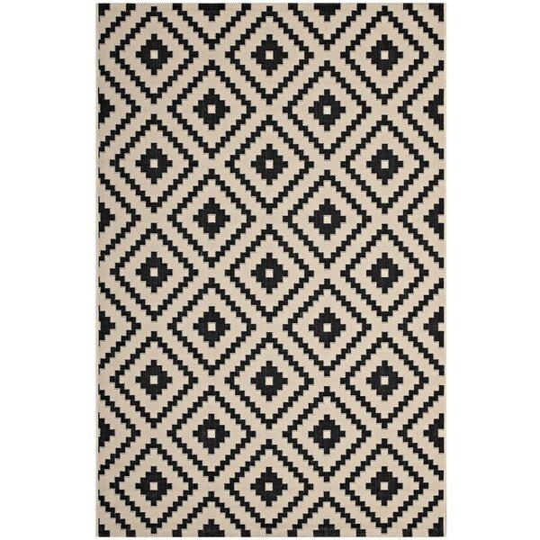 Eisen Geometric Trellis Black/Beige Indoor/Outdoor Area Rug by Wrought Studio