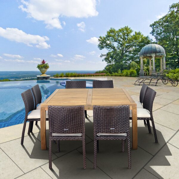 Destiney International Home Outdoor 9 Piece Teak Dining Set with Cushions by Rosecliff Heights