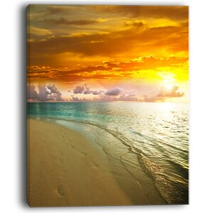 Amazingly Colorful Beach with Footprints - Seashore Photographic Print on Wrapped Canvas by Design Art