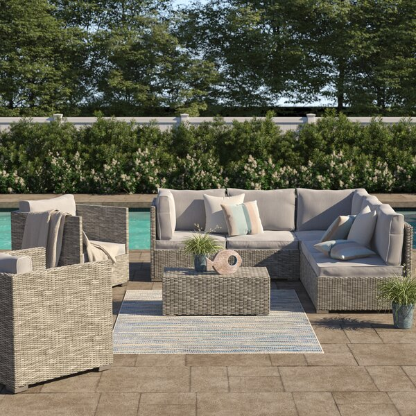 Heinrich 8 Piece Rattan Sectional Set with Cushions by Highland Dunes