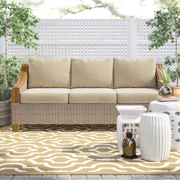 Kincaid Teak Patio Sofa with Sunbrella Cushions by Rosecliff Heights