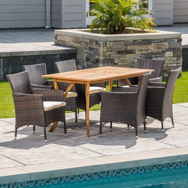 Goetsch Outdoor Acacia Wood/Wicker 7 Piece Dining Set with Cushions by Wrought Studio