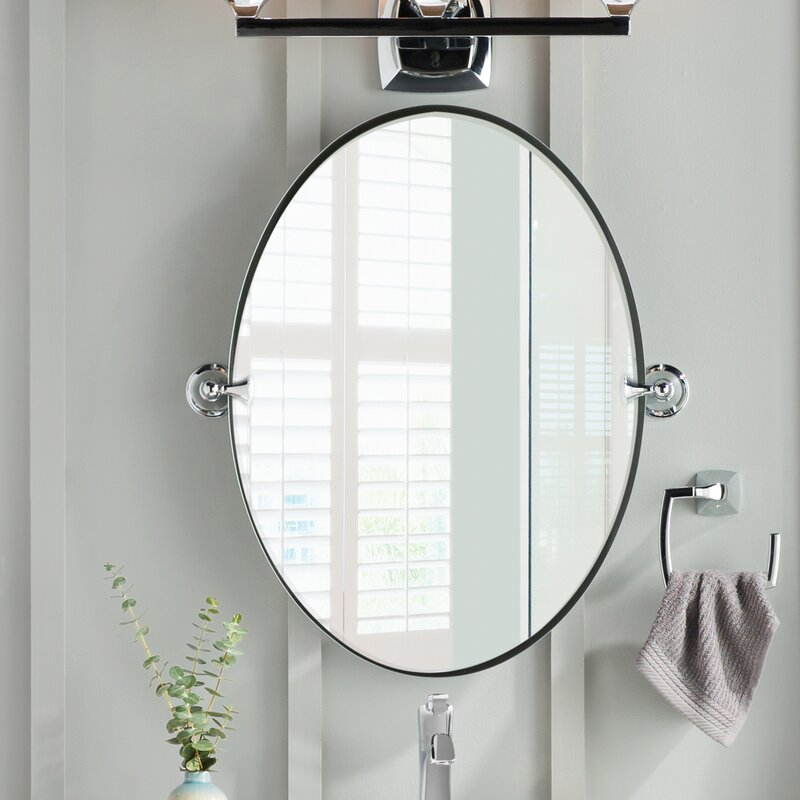 This oval-shaped mirror features a contemporary design.