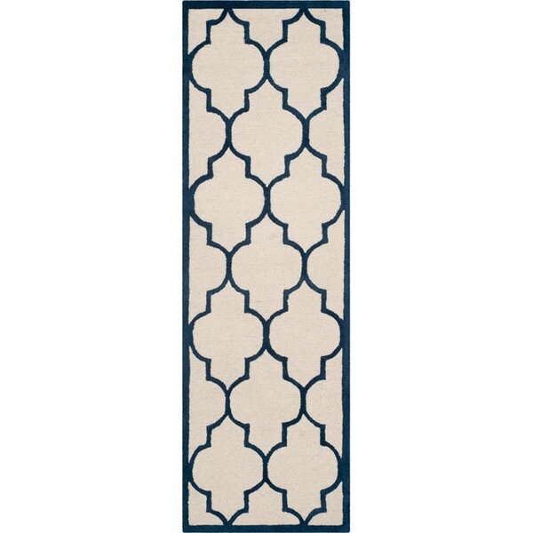Charlenne Hand-Woven Wool Ivory / Navy Area Rug by Zipcode Design