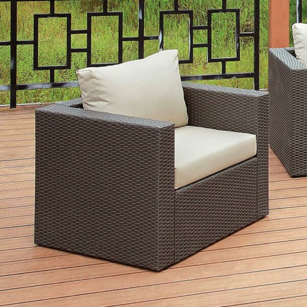 Irvington Faux Rattan Patio Chair with Cushions by Ivy Bronx