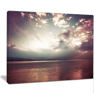 'Dark Sunset with Dramatic Sky' Photographic Print on Wrapped Canvas by Design Art
