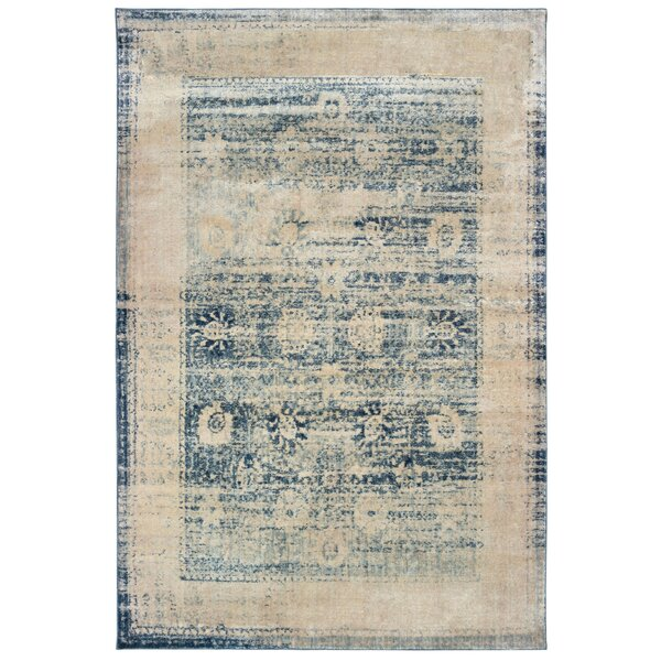 Pateros Distressed Border Ivory/Blue Area Rug by World Menagerie