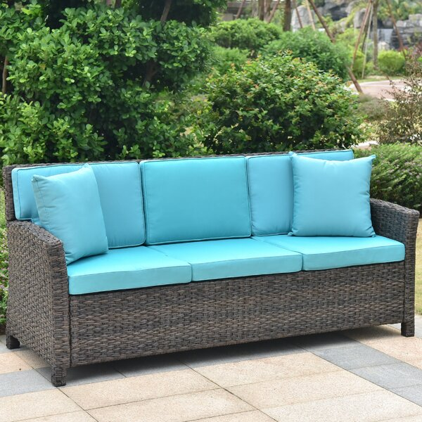 Deanna Resin Wicker Patio Sofa with Cushions by Red Barrel Studio Red Barrel Studio