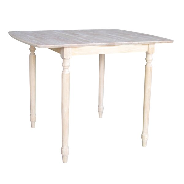 Telles Solid Wood Dining Table by Charlton Home