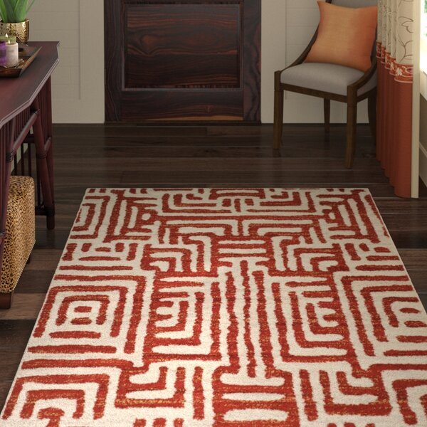 Vadim Ivory/Terracotta Area Rug by World Menagerie