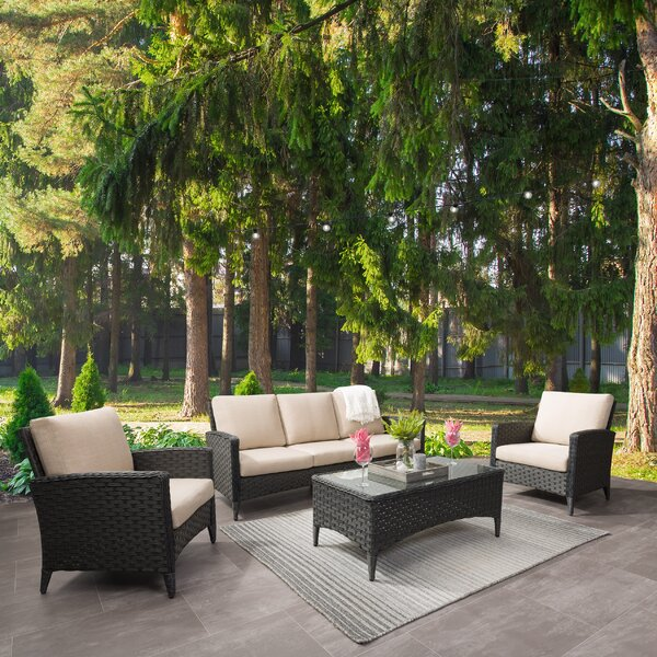 Ja Wide 4 Piece Rattan Sofa Seating Group with Cushions by Highland Dunes