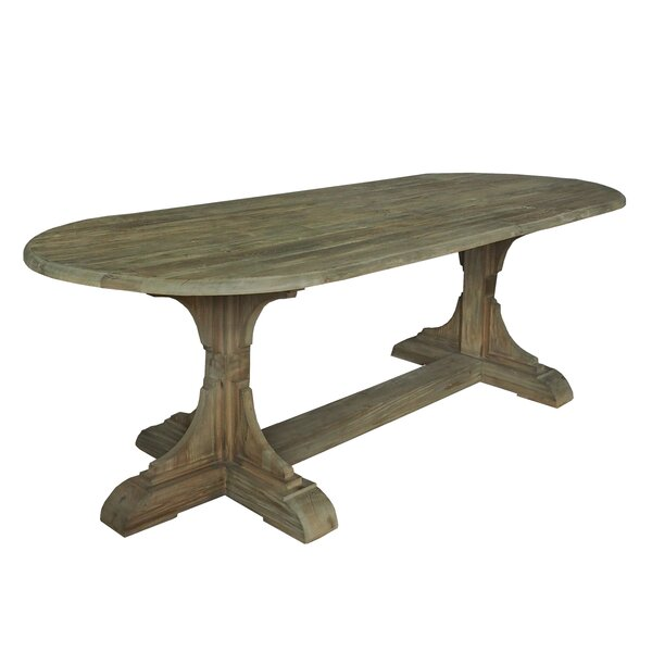 Llewellyn Solid Wood Dining Table by 17 Stories