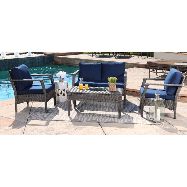 Henshaw Outdoor Wicker 4 Piece Patio Conversation Set with cushion by Highland Dunes
