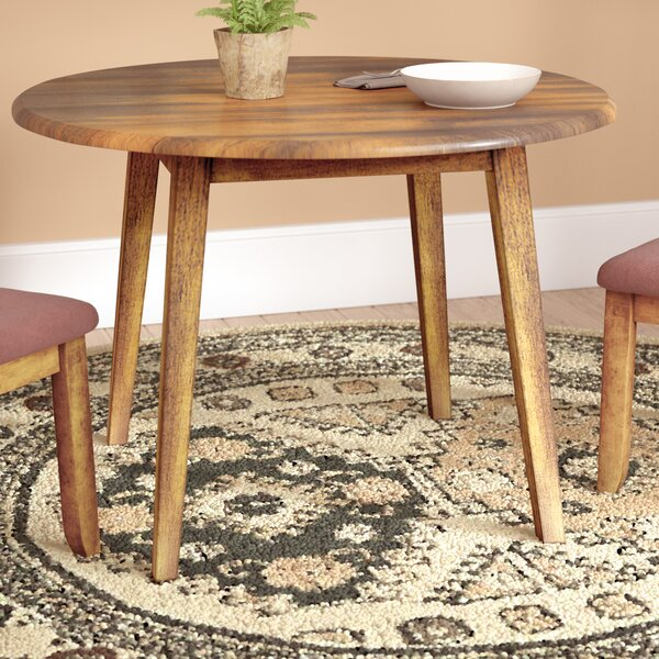Solange Extendable Dining Table by Bay Isle Home