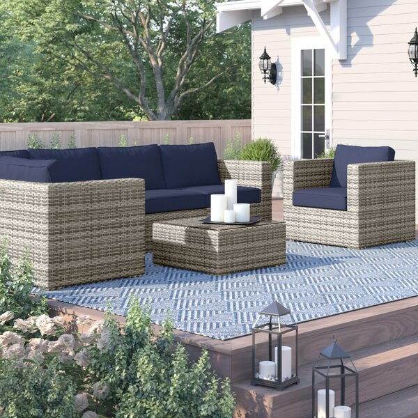 Clem 7 Piece Sunbrella Sectional Seating Group with Cushions
