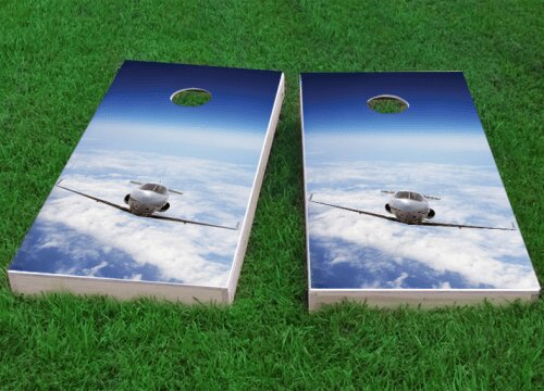 Private Jet Flying Above the Clouds Cornhole Game (Set of 2) by Custom Cornhole Boards