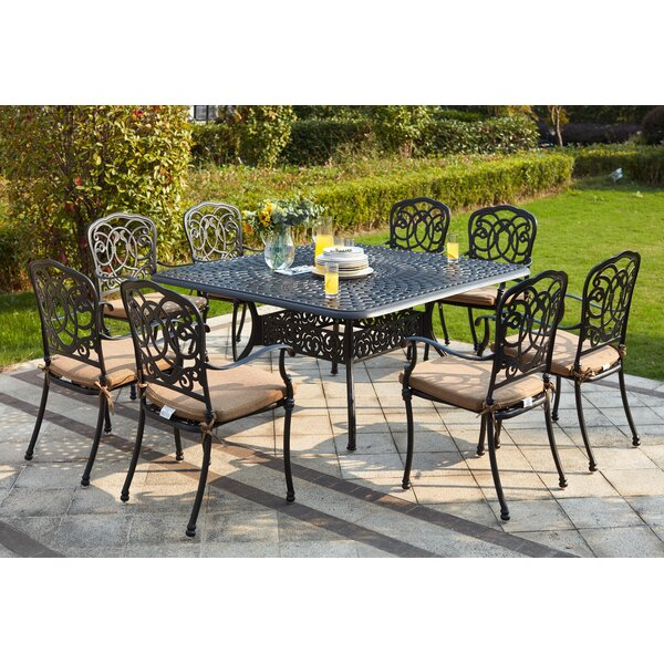 Battista Traditional 9 Piece Metal Frame Dining Set with Cushions by Fleur De Lis Living
