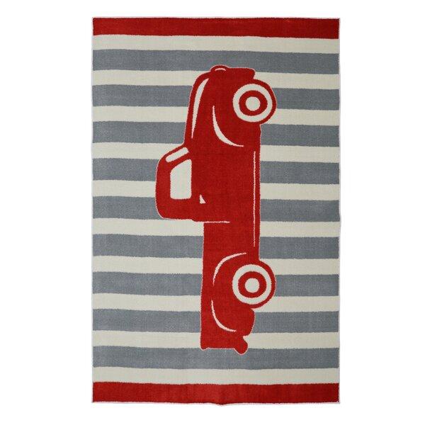 Brynn Vintage Truck Crimson Red Area Rug by Viv + Rae