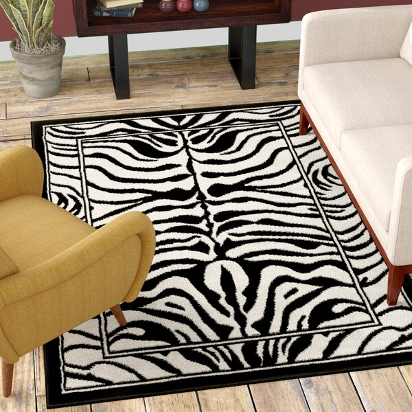 Kaly Zebra Print Ebony Area Rug by World Menagerie