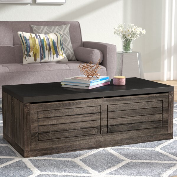 Raul Coffee Table with Storage by Brayden Studio