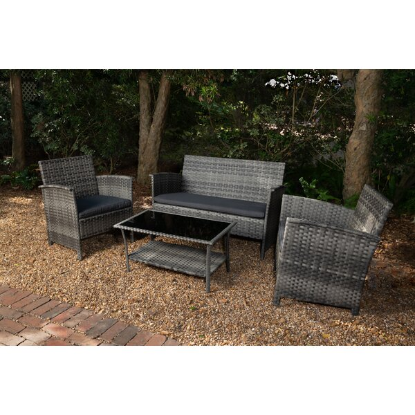 Plumville 4 Piece Rattan Sofa Seating Group with Cushions by Wrought Studio