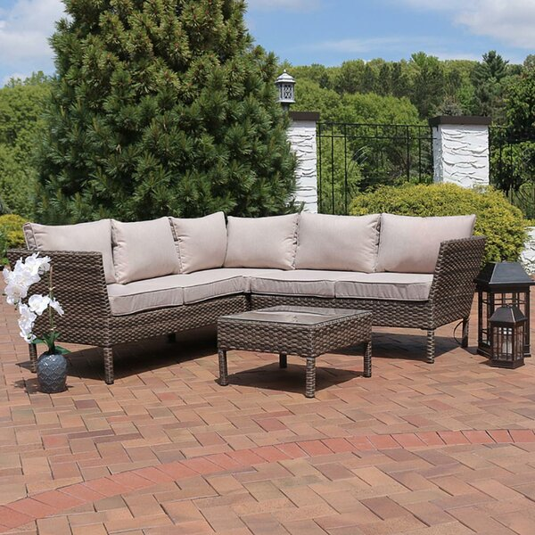 Buie 4 Piece Rattan Sectional Seating Group with Cushions by Ivy Bronx