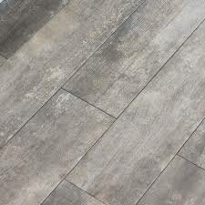 Farmstead 6 x 24 Porcelain Wood Look Tile in Coffee by Parvatile