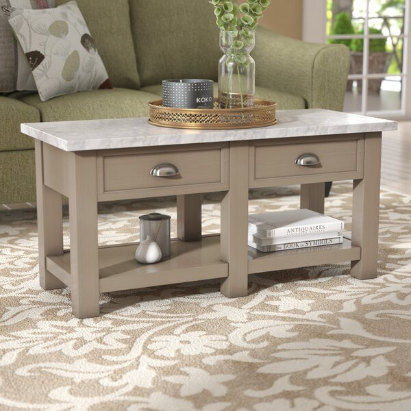 Burket Faux Coffee Table by Three Posts